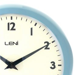 Zoom in of light blue framed clock with white face and black hands