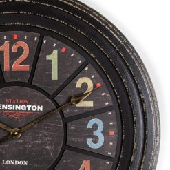 Brass hands shown on clock face with pastel red green yellow and blue numerals