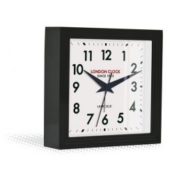 Front view of express mantle clock in black showing black hands and clear numbers
