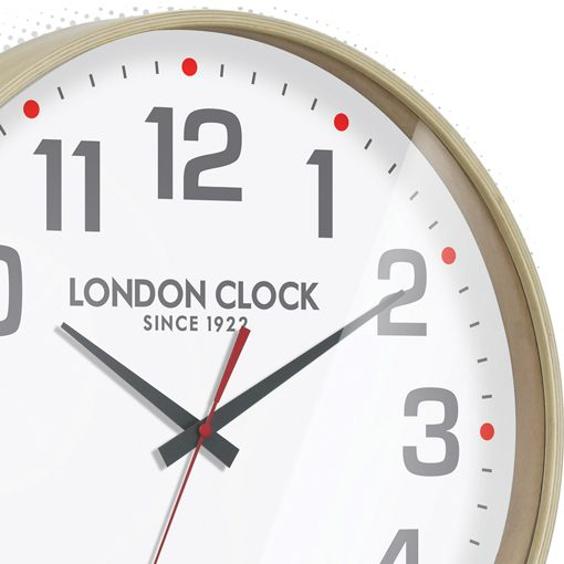 Close up of the modern styled small boho clock which has fine red detailing in the second hand and 5 minute notches