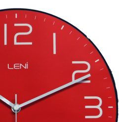 Close up of classique red wall clock with stunning slender metal hands and bright simple finish