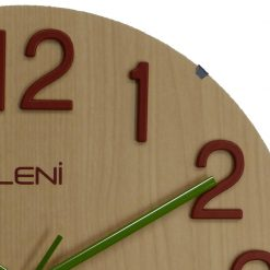 Close up of blond wooden wall clock with red numerals and green hands