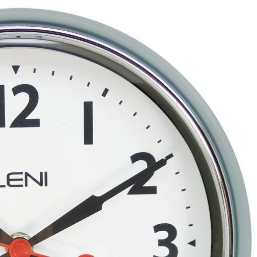 Image shows the elegant hands of Leni wall clock and fine chrome finish