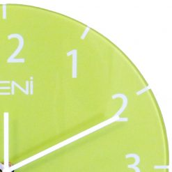 Curved edges of glass wall clock shown and fine white numbers