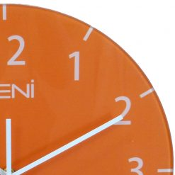 Close up shows white numerals and hands of wall clock