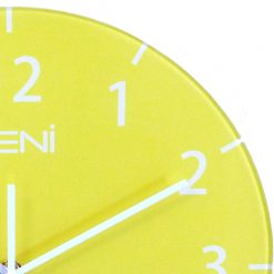 Bright yellow glass of wall clock shown close up