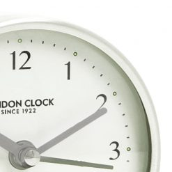 Close Up image of Forme White Resin Wood Alarm Clock with White Trim