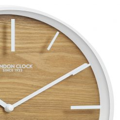 Close Up image of Skog White Case Glass Wall Clock with Off-White Trim