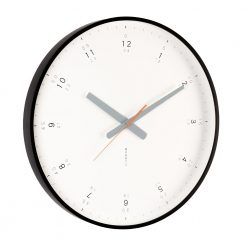 Large black modern wall clock shown on angle highlighting solid frame