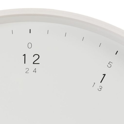 Detail shown of large white wall clock with wooden frame and fine black numerals