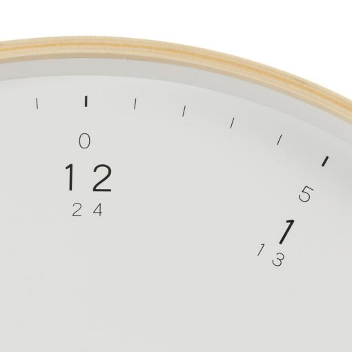 Close up view of modern wooden wall clock showing fine black minute marks and numerals