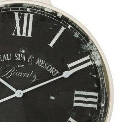 Close up of Round Antique Wall Clock with White Hands