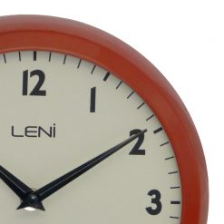 Zoomed in of Red Wall Clock with Black Hands