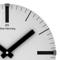 Zoomed in of White Glass Wall Clock with Black Hands