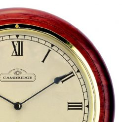 Close up of Red Round Small Station Clock with Roman Numerals