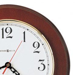 closedup brown wooden wall clock