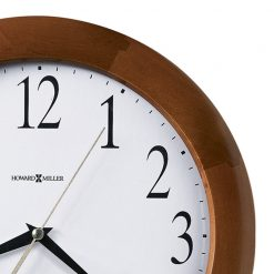 closedup brown wooden round wall clock