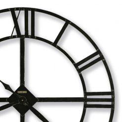 closeup black and white iron wall clock