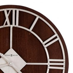 brown wall clock on a roman numerals number