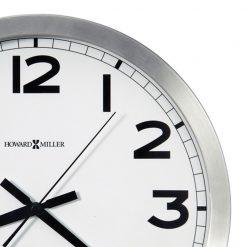Closeup Silver and white wall clock