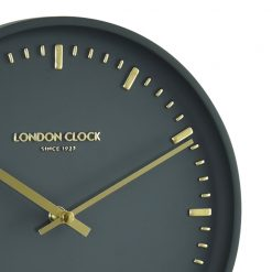 Close up of black wall clock with gold markings