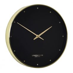 Sleek black clock with gold hands and frame