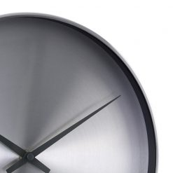 Close up of chrome wall clock with black hands