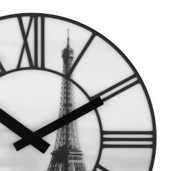 Close up on La Ville wall clock showing Eiffel Tower image and black hands