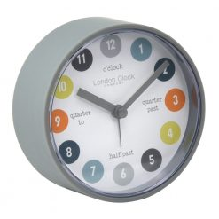 Grey alarm clock with helpful time phrases on face