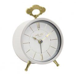 Cream coloured alarm clock with gold legs