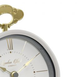 Close up of cream alarm clock showing gold finishings