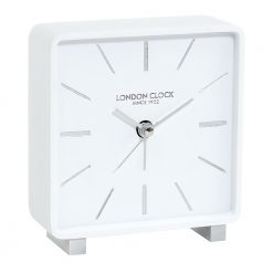 White alarm clock with silver etchings and feet