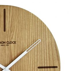 Close-up of round wooden Eldo wall clock with white hands