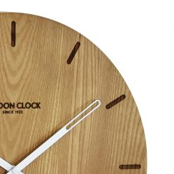 Close-up of round wooden Elis wall clock with white hands