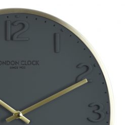 Close-up of round grey Elvie wall clock with gold color hands