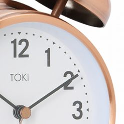 Close-up photo of 18cm brushed copper colour alarm clock with twin bells