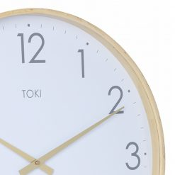 Close-up photo of silent sweep wooden clock with white face