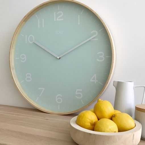 Lifestyle photo of 51cm wall clock with wooden case and duck egg colour face