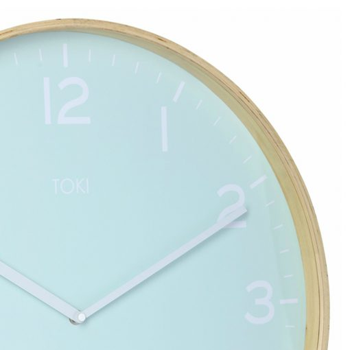 Close-up photo of large silent sweep clock with wooden case and duck egg colour face