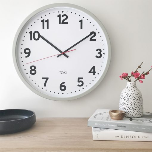 Lifestyle photo of silent sweep 50cm wall clock with cool grey case and white face