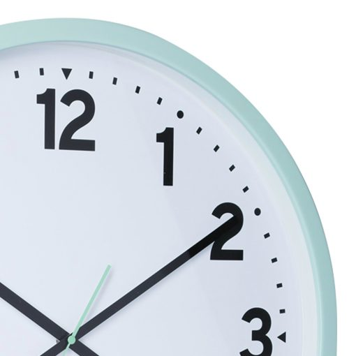 Close up photo of duck egg coloured 50cm wall clock with white face