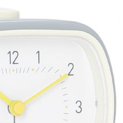 Close up photo of cool grey colour alarm clock with white face and silent sweep