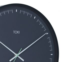 Close up photo of large black wall clock with duck egg coloured hands