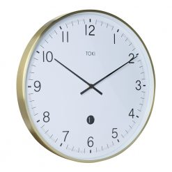 Photo of large wall clock with brushed gold outer case, date display and white face