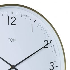 Close-up photo of 40cm brushed gold silent sweep clock with date display and white face
