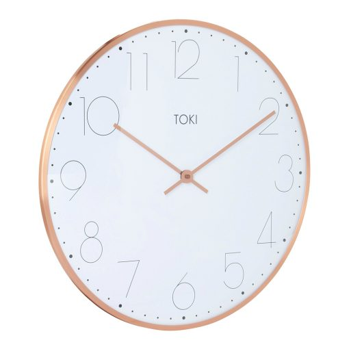 Photo of large wall clock with rose gold case and white face