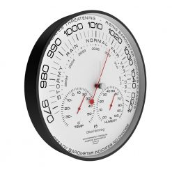 Sideview photo of simple barometer wall clock with black numbers, white hands and red hands