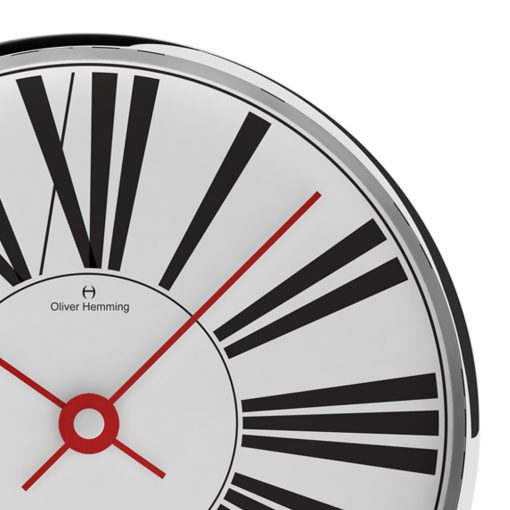 Close-up photo of 40cm contemporary wall clock with large black numerals and red hands