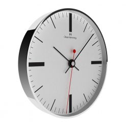 Sideview photo of simple wall clock with chrome case, black hands and black markers