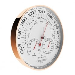 Side view image of weather station wall clock with red hands, black numbers and rose copper outer rim